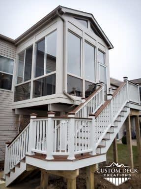 Outside stairs leading to a 2nd story sunroom