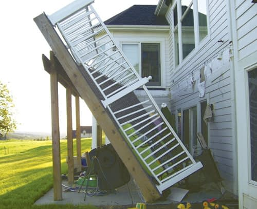 Deck that collapsed fell off the side of a house where it was ledgered