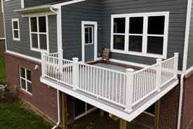 White and grey composite deck built on the back of a home in Cherry Hill, Canton, Michigan
