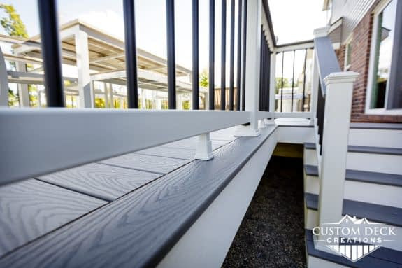 Close up of a grey deck with white fascia and stairs built by Custom Deck Creations