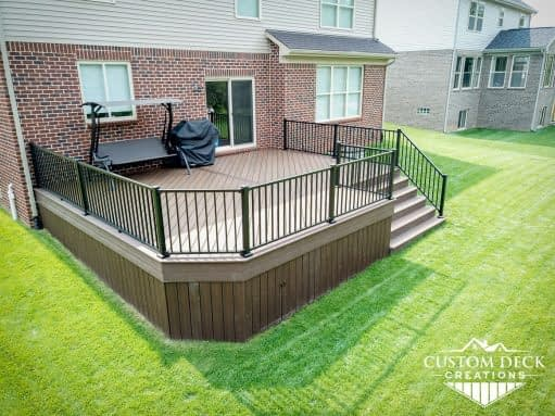 Outdoor Trex deck in Canton Michigan with skirting and built in access panel