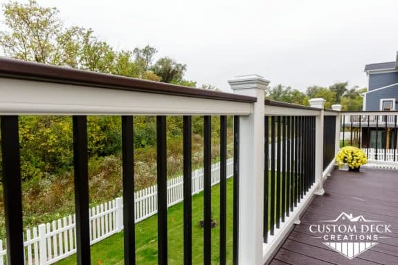 White and black railing on a composite deck
