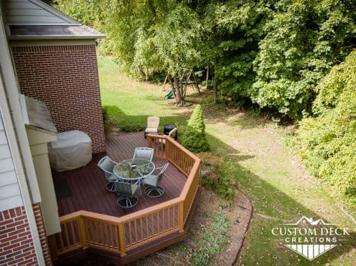 Aerial view of a brown deck in an open backyard