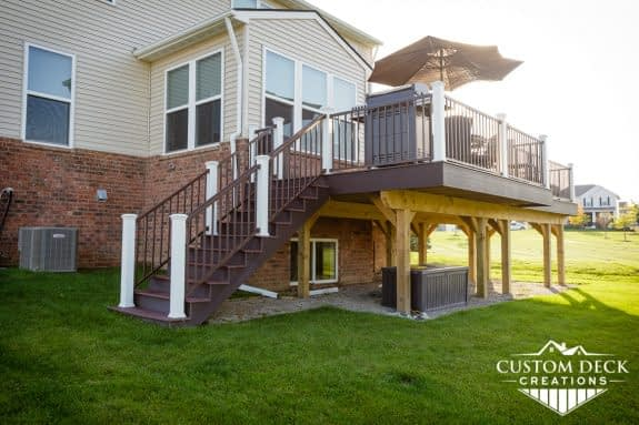 Backyard view of a new construction home with a composite Trex deck built in New Hudson Michigan