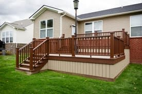 Trex Composite two-tiered deck with unique light post on it and skirting in Canton Michigan