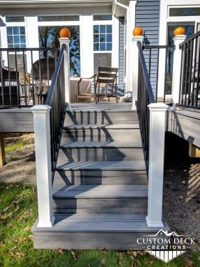 Composite Trex stairs in grey and white built by Custom Deck Creations