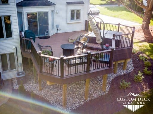 2nd story backyard deck with beeautiful landscaping rocks and mulch around it