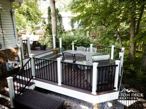Brown and white deck with multiple sets of stairs off the back of a home in Northville Michigan