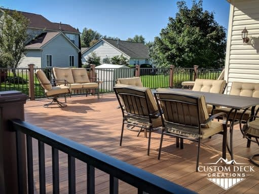 Large backyard composite deck in brown and black
