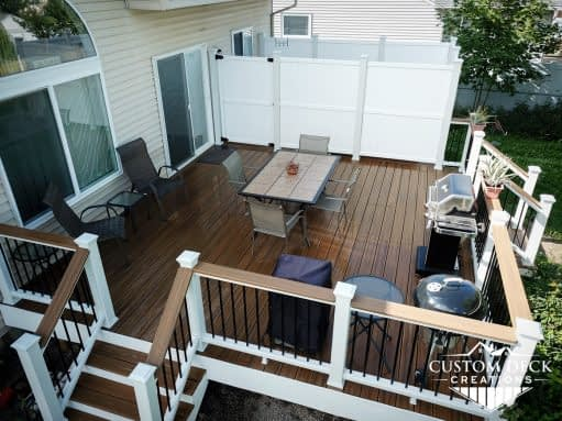 Aerial view of a brown composite deck with private hot tub