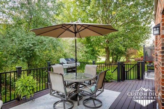 Patio table with umbrella in a backyard deck in Ann Arbor Michigan