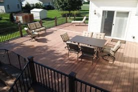 Large outdoor composite deck with aluminum railing and lounge furniture