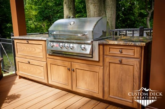 Built in outdoor kitchen with grill and granite