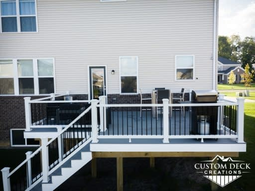 Grey and white composite Trex backyard deck built by Custom Deck Creations