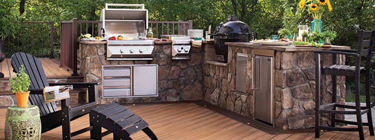 Outdoor kitchen with stone veneer on composite deck