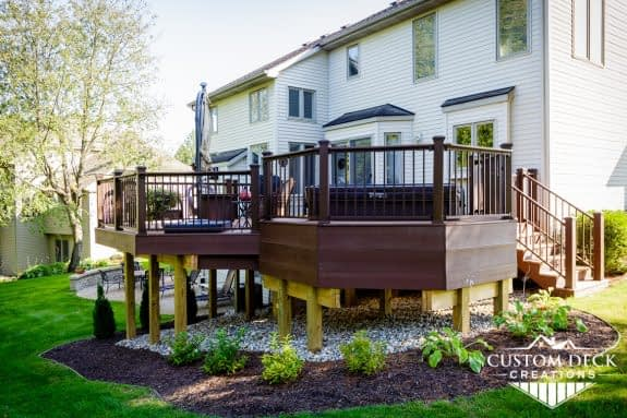 Backyard composite deck with built in hot tub