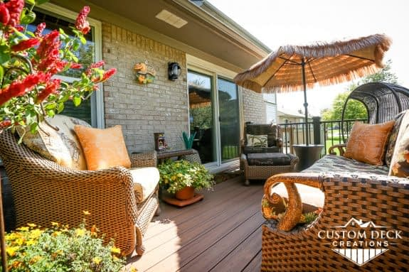 Brown backyard deck off a condo decorated with Hawaii theme
